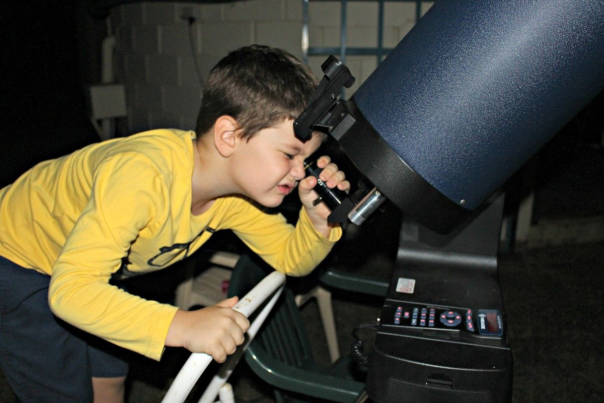 lucas outside with telescope